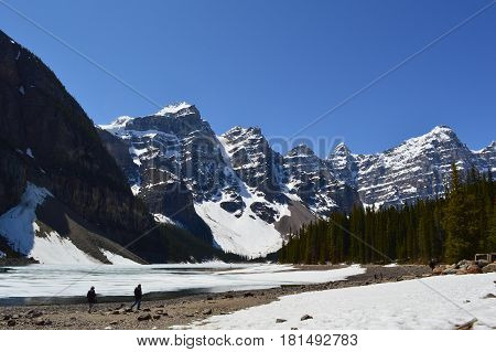 Moraine Lake is still frozen  in Alberta, Canada, by the end of winter