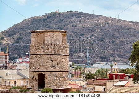 An ancient watchtower on a hill. Cartagena, Spain