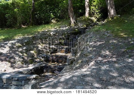 picture shows a Stairs-like small waterfall by the kylemore abbey in ireland