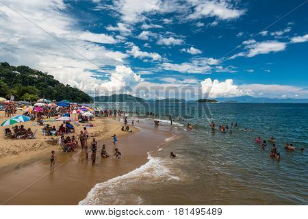 Angra dos Reis, Brazil - February 27, 2017: The beach full of people with families. During Rio Carnival holidays, many people get out of busy city and visit nearby areas like this one.