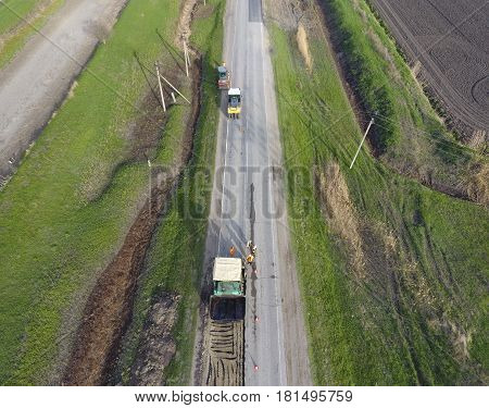 Top View Of The Road Repair. Technics For Repair Of Asphalt. Replacement Of Asphalt Pavement.