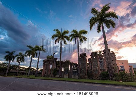 Ruins of Sugar Mill of Colonial Times in Brazil, with Palm Trees by Sunset