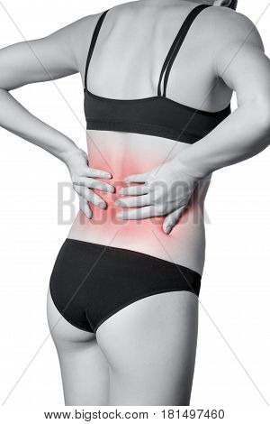 Closeup view of a young woman with pain in back. isolated on white background. Black and white photo with red dot.