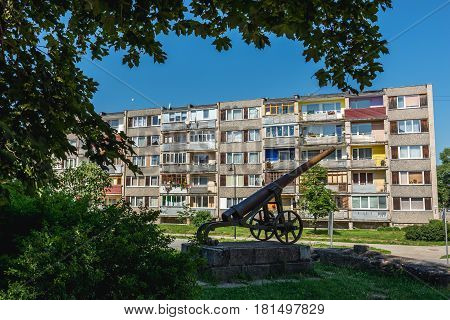Monument with an old cannon in 19th century military fortress in Daugavpils Latvia