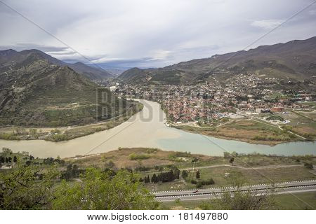 Merge of two rivers, beautiful landscape, hillsides, hills. Sights and nature of the North Caucasus, Georgia