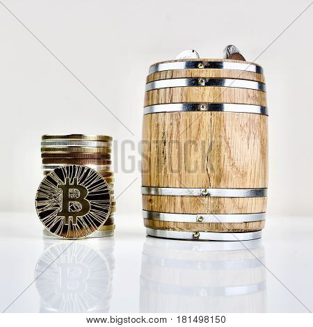 Gold bitcoin coin physical cryptocurrency and wooden barrel