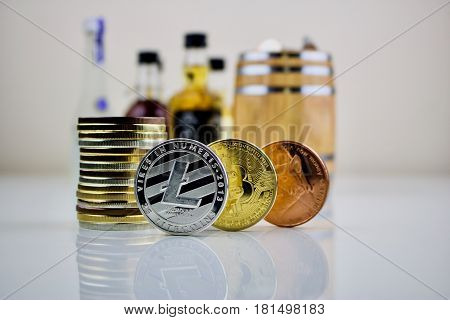 Three cryptocurrency physical coins - Litecoin, Bitcoin, Dogecoin