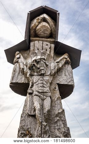 Single wooden cross on site of pilgrimage called Hill of Crosses Lithuania