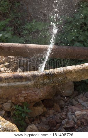 splashes of water from the pipe . A photo