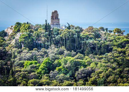 Monument of Philopappos on Musaios Hill seen from Acropolis hill in Athens Greece