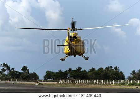 Helicopter hovering during take off on a remote airfield