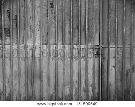 Textures of an iron fence background wallpaper color black white material metal rust old surface pattern