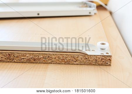 Furniture Accessories Lying On The Chipboard