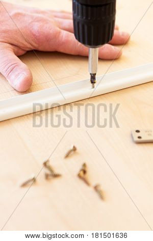 The Man Does The Work Of Assembling Furniture