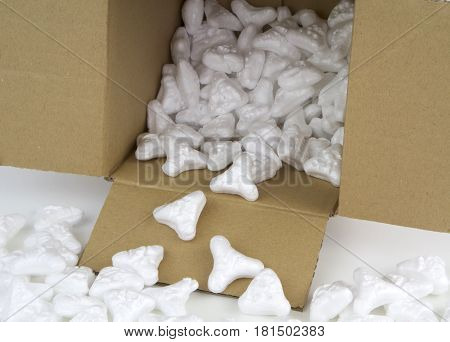 Styrofoam peanuts for the protection of fragile packages close up image