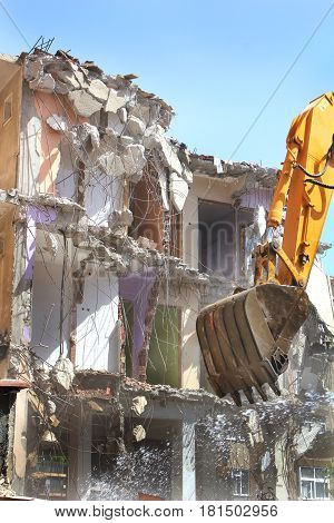 Excavation machinery and building demolition close up image