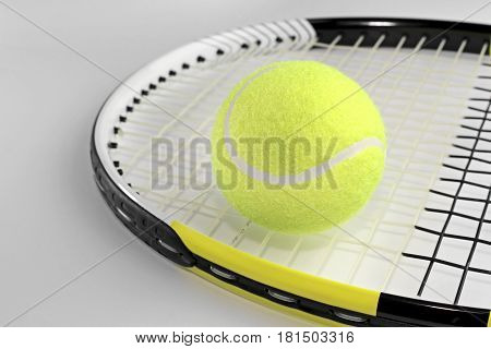 Tennis ball on a racket close up image