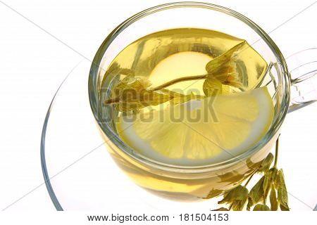 Herbal tea, sage leaves and lemon slice close up mage