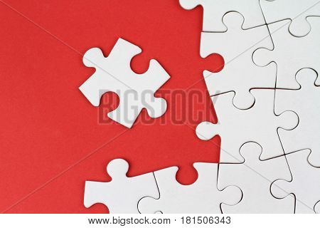 Puzzle pieces on red background close up image