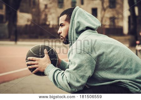 African-american streetball player resting at playground