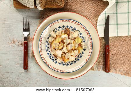 Chicken ragout served for dinner on wooden table