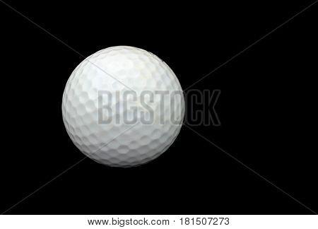 White golf ball isolated on black background .