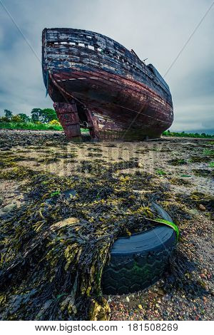 Abandoned Shipwreck On Shore In Fort William In Summer, Scotland