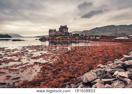 Stunning Dusk Over Loch At Eilean Donan Castle In Scotland