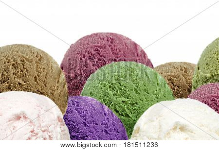 Delicious ice cream scoops isolated on white background, close up image.
