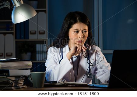 Worried Doctor Having Bad Diagnosis At Night