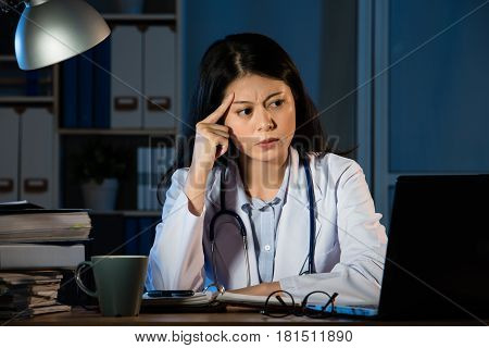 Frustration Female Doctor Looking At Computer