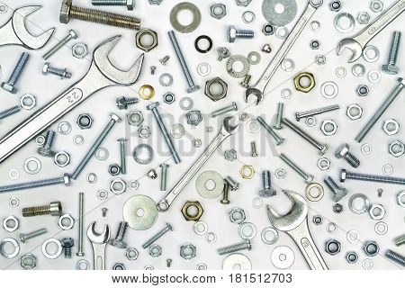 Bolts, nuts, and washers on white background
