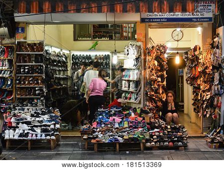 Hanoi Vietnam - Feb 19 2107 : A woman is sitting in her shop specialized in the selling of shoes in Hanoi Vietnam
