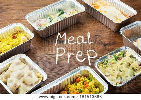 The Word Meal Preparation Written On Table With Takeaway Meal In Foil Containers