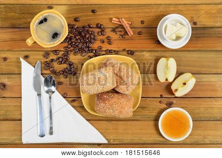 What's your craving for breakfast today. Crispy multi-grain rolls with butter and apple jelly - warm and delicious, with black tea for a drink.