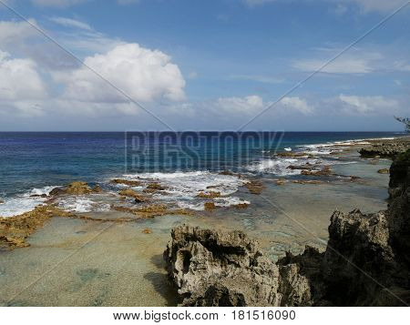Coastal scenic views, Rota, Northern Mariana Islands coastal area lined up with rock formations and corals