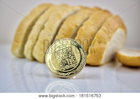 Physical cryptocurrency coin gold titan bitcoin and bread poster