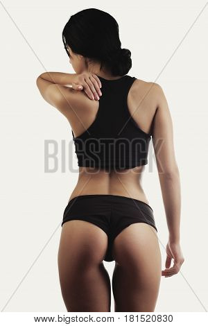 beautiful sporty muscular woman back isolated pain hand