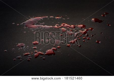 Spilled blood. Drops on black surface crime and violence theme