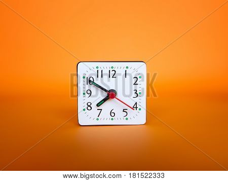 Clock on abstract bright background. Sparse composition
