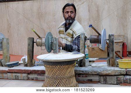 AGRA, INDIA - FEBRUARY 14: Craftsman works in a workshop making inlaid marble in Agra, Uttar Pradesh, India on February 14, 2016.