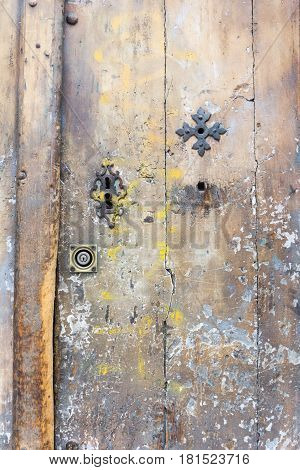 Faded worn old door with key holes
