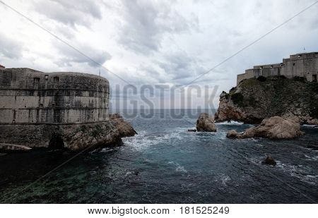 DUBROVNIK, CROATIA - NOVEMBER 07: Old port Kolorina, with the two forts Bokar and Lovrijenic standing as sentinals as defence of the walls of Dubrovnik, Croatia on November 07, 2016.