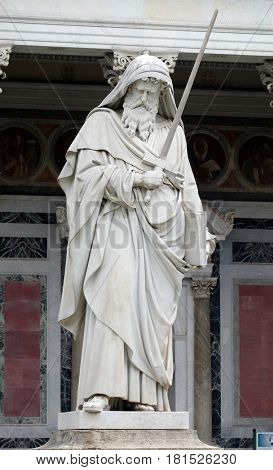 ROME, ITALY - SEPTEMBER 05: Saint Paul statue in front of the basilica of Saint Paul Outside the Walls, Rome, Italy on September 05, 2016.
