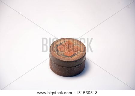 Thailand. April 09 2017 : An Old round steel case. The Thai wording on case meaning is Miracle medicine. 09 Apil 2017. Thailand.