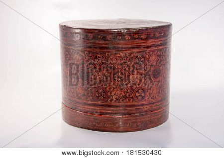 An old wooden case with flower pattern. Object.