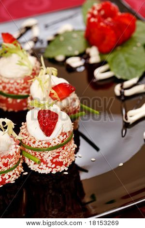 Tiramisu Sushi Roll garnished with Strawberry and Mint