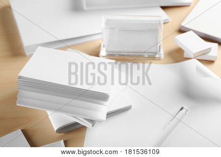 Blank office supplies on wooden background