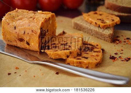 Homemade butter with sun-dried tomatoes for spreads on a backing paper. Healthy food concept
