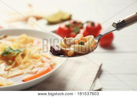 Spoon of chicken tortilla soup